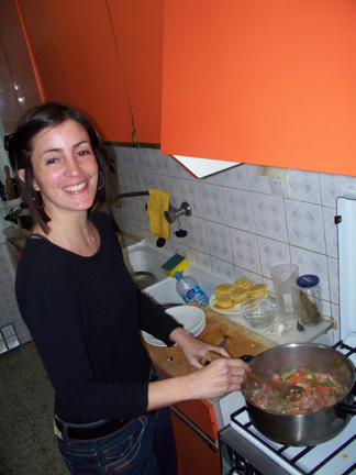 Sonia cooking up Moros con Cristianos